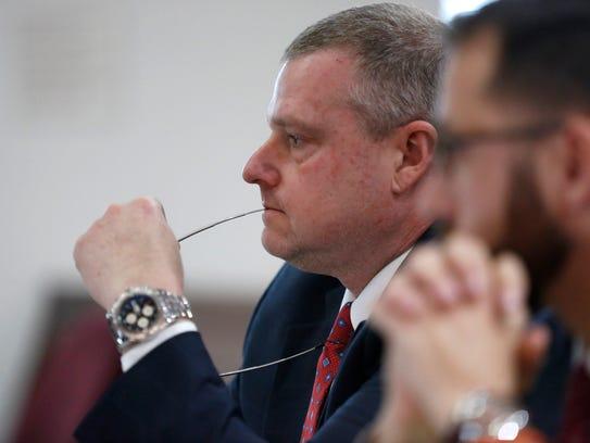 State Prosecutor Jon Fuchs listens to the proceedings