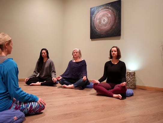 Instructor Shannon McGee leads a meditation for staff