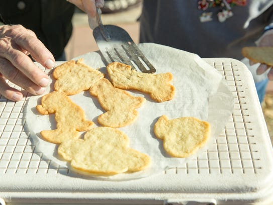 Campfire Christmas cookies are dished out at the New Mexico Farm & Ranch Heritage Museum on Saturday, December 23, 2017.