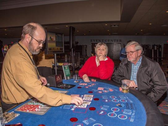 Linda and Butch Evans enjoy playing 3-card poker at