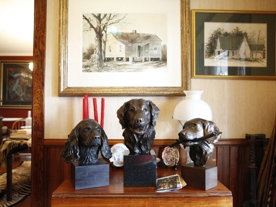 Some of Sandy Proctor's sculptures of dogs he has owned
