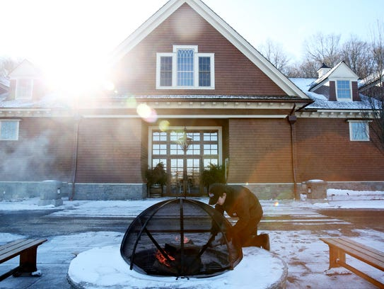 Derek Vose of Verbank prepares the fire pit outside