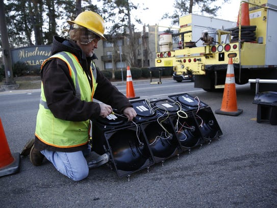 COT Traffic Signal Technician Mike Hall reconfigures