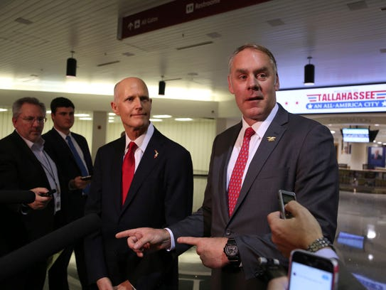 Florida Gov. Rick Scott (left) and U.S. Interior Secretary Ryan Zinke announce there will be no new offshore drilling in Florida. Both met at the Tallahassee International Airport on Tuesday, Jan. 9, 2018.