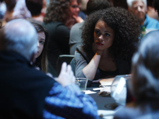 Devair Jeffries listens to a table-mate as they share