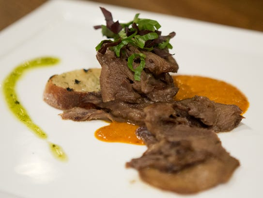 Southern Colorado bison tongue with roasted bell pepper sauce at the Welsh Rabbit Cheese Bistro.