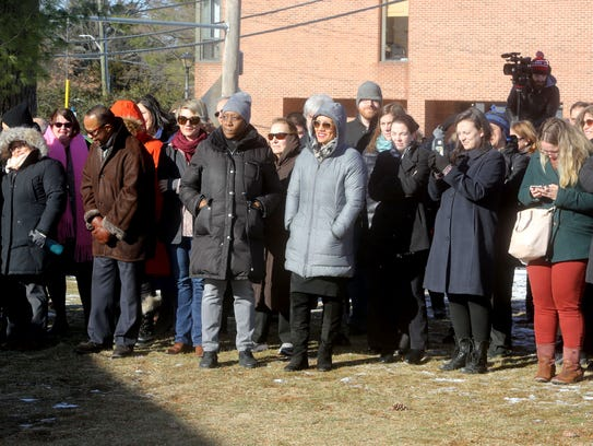 Faculty, students, and members of the community gather