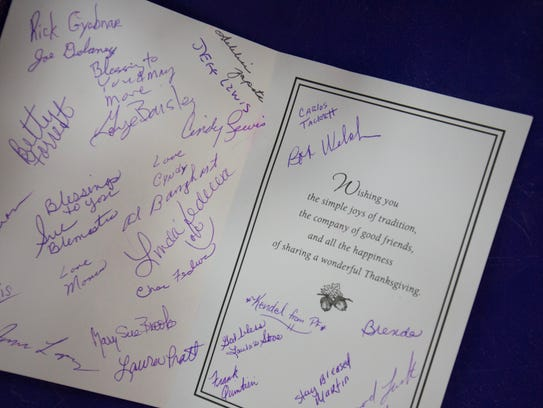 Gym members signed a Thanksgiving card for Karen Hartigan