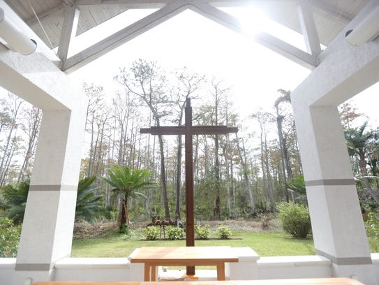 A cross stands in the garden behind St. Mary's Episcopal