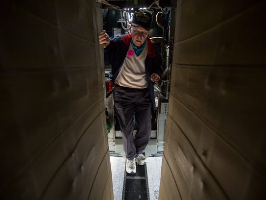 Ernie Kunz, 92, steps onto the walkway after landing