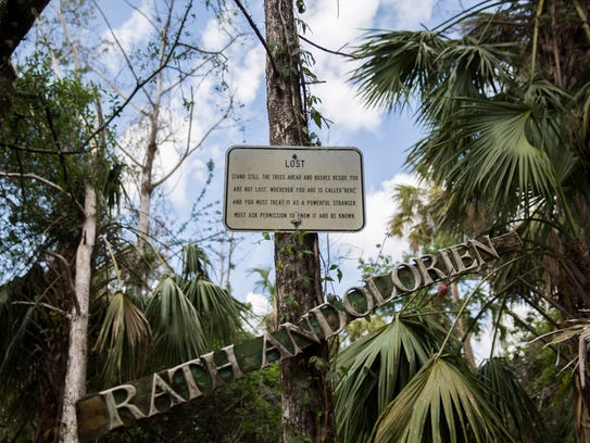 """A sign titled """"Lost"""" hangs on tree in the Naithloriendun"""