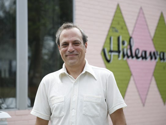 Midtown Merchants Association President Don Quarello poses in front of his coffee shop, the Hideaway.