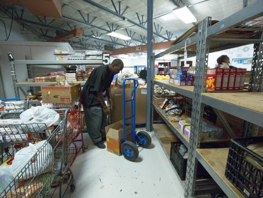 Chris Boykin unloads boxes of cookies and cakes into