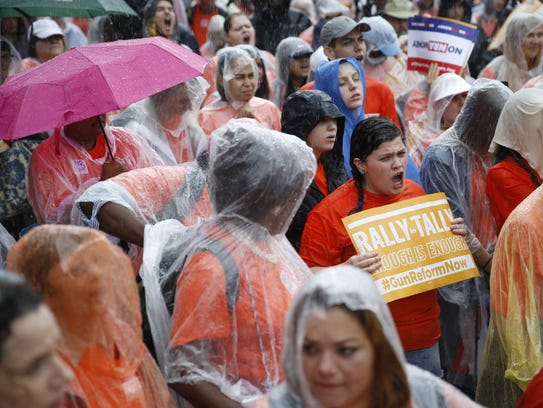 More than 1,000 protesters braved Monday's downpour to call on legislators to pass stricter gun laws during the Rally in Tally at the Capitol.
