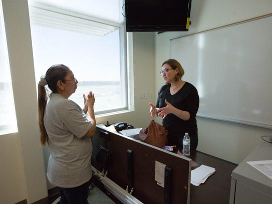 Amy Himelright, right, employee assistance program coordinator for Las Cruces Public Schools, talks with Danielle Cheromiah, a food services employee at Hillrise Elementary School, about ways to stay in the moment when meditating on Friday, March 2 at Centennial High School.