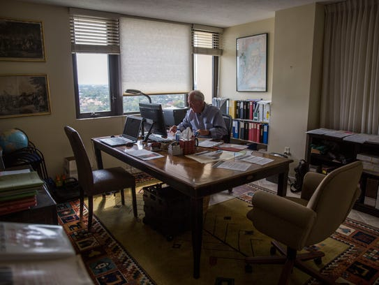 Thomas Tyrrell, 82, sits in his office at his home