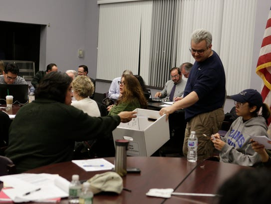 Lou Russo of Port Chester collects ballots for a chair