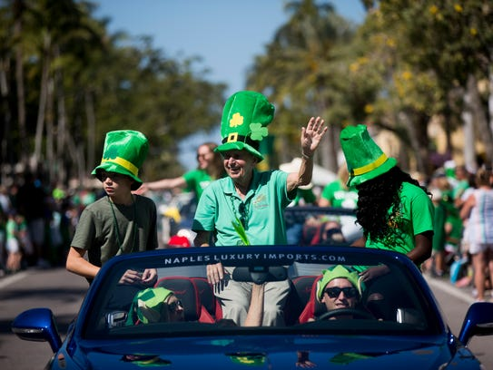 Naples mayor Bill Barnett waves to the thousands of