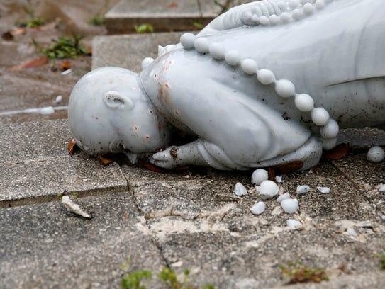 Vandalized statues at Vien Giac Buddhist Monastery