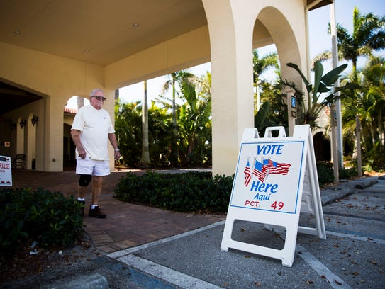 A voter exits the polling station during the 2018 Bonita