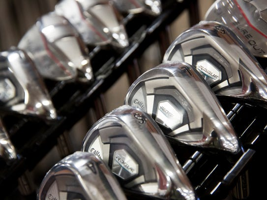 Rows of golf clubs are lined up at the PGA TOUR Superstore
