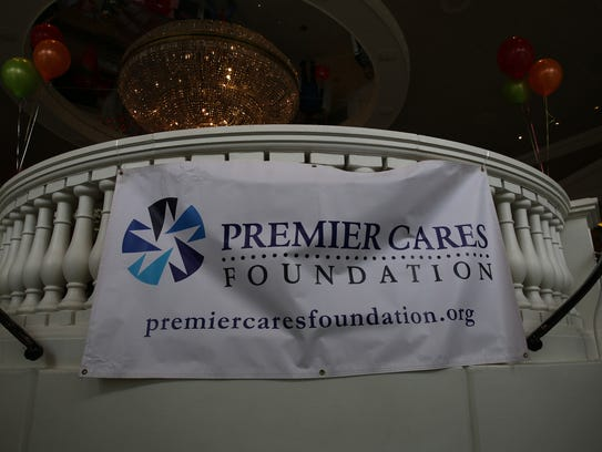 A sign for the Premier Cares Foundation hangs on Sunday.