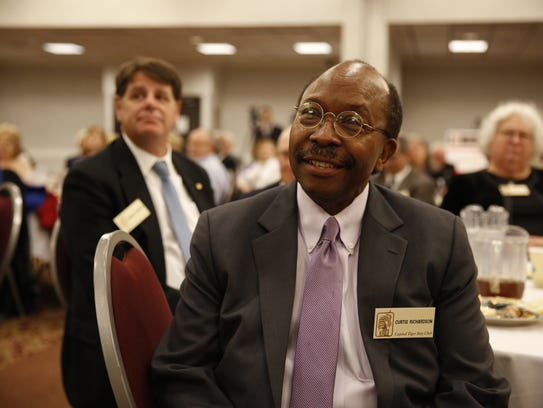 City Commissioner Curtis Richardson listens to former