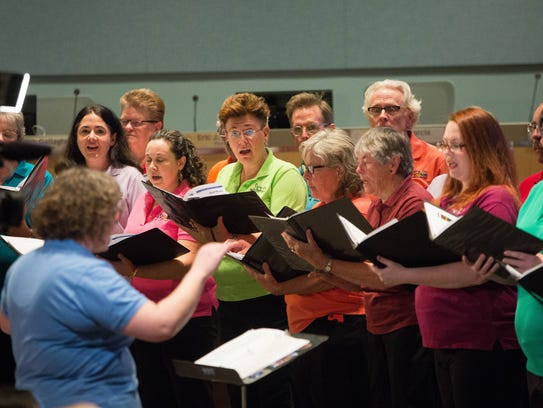 Singing Out Las Cruces, an LGBT choir, performs before
