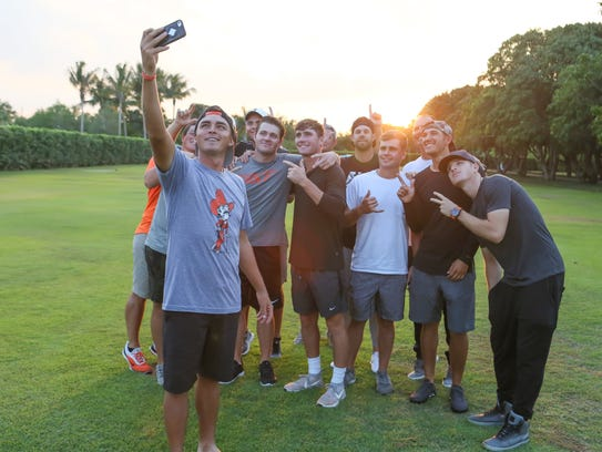 Rickie Fowler takes a selfie with Oklahoma State golfers.