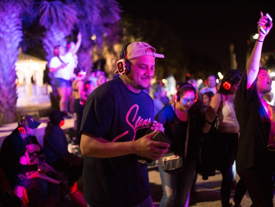 A man dances during the Silent Disco at Fiesta de la