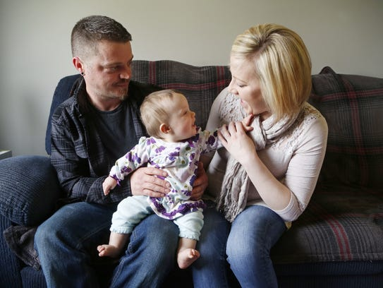 James Gustin and Andrea Heichelbech with their 10-month-old