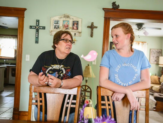 Hailey Byers, right, with her grandmother Ann Byers at her home in Le Mars, Iowa, May 8, 2018. Hailey never met her father, Casey Byers, who was killed in action while serving in Iraq. She's being raised in Le Mars by his parents, Bill and Ann Byers.