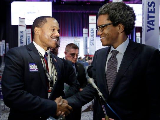Attorney General candidate Joe Holland, left, congratulates