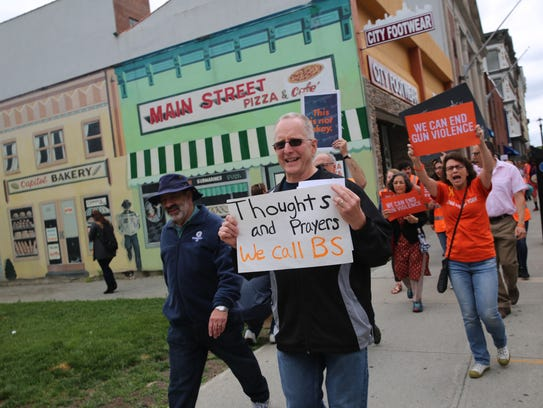 Hyde Park resident Dave Wolf, 60, marches through Poughkeepsie