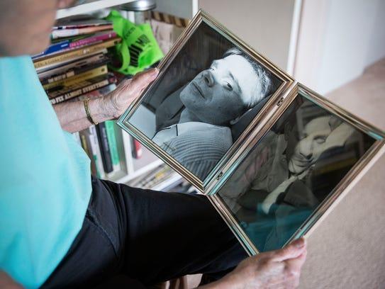 Zana Cloyd looks over photographs of her son Joe who