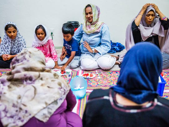 Women break their fast together during the 22nd night