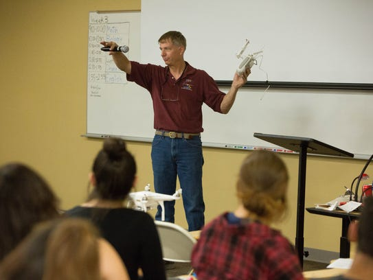 Tim Lower, an Unmaned Aerial Systems flight operator with New Mexico State University's Physical Laboratory, talks to high school students about the UAS and UAV programs at NMSU and the research and development they do with drone technology, during a presentation at the ACT Summer Program, where students not only study for the ACT's but also see where a career in STEM can start at NMSU and Doña Ana Community College. Wednesday June 13, 2018.