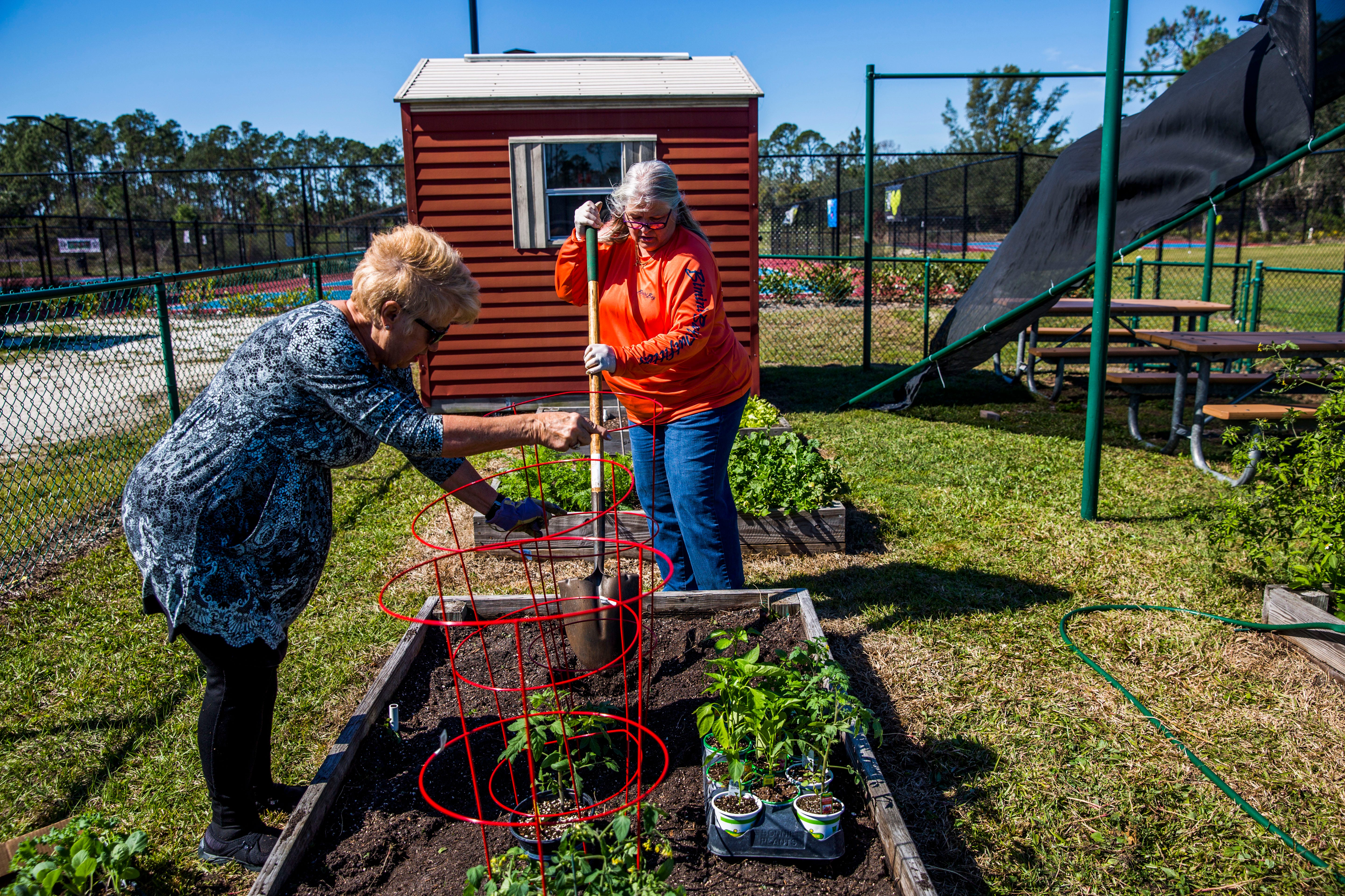 Pam Houndt, Right, And Merril Vitek Tend To Their Garden