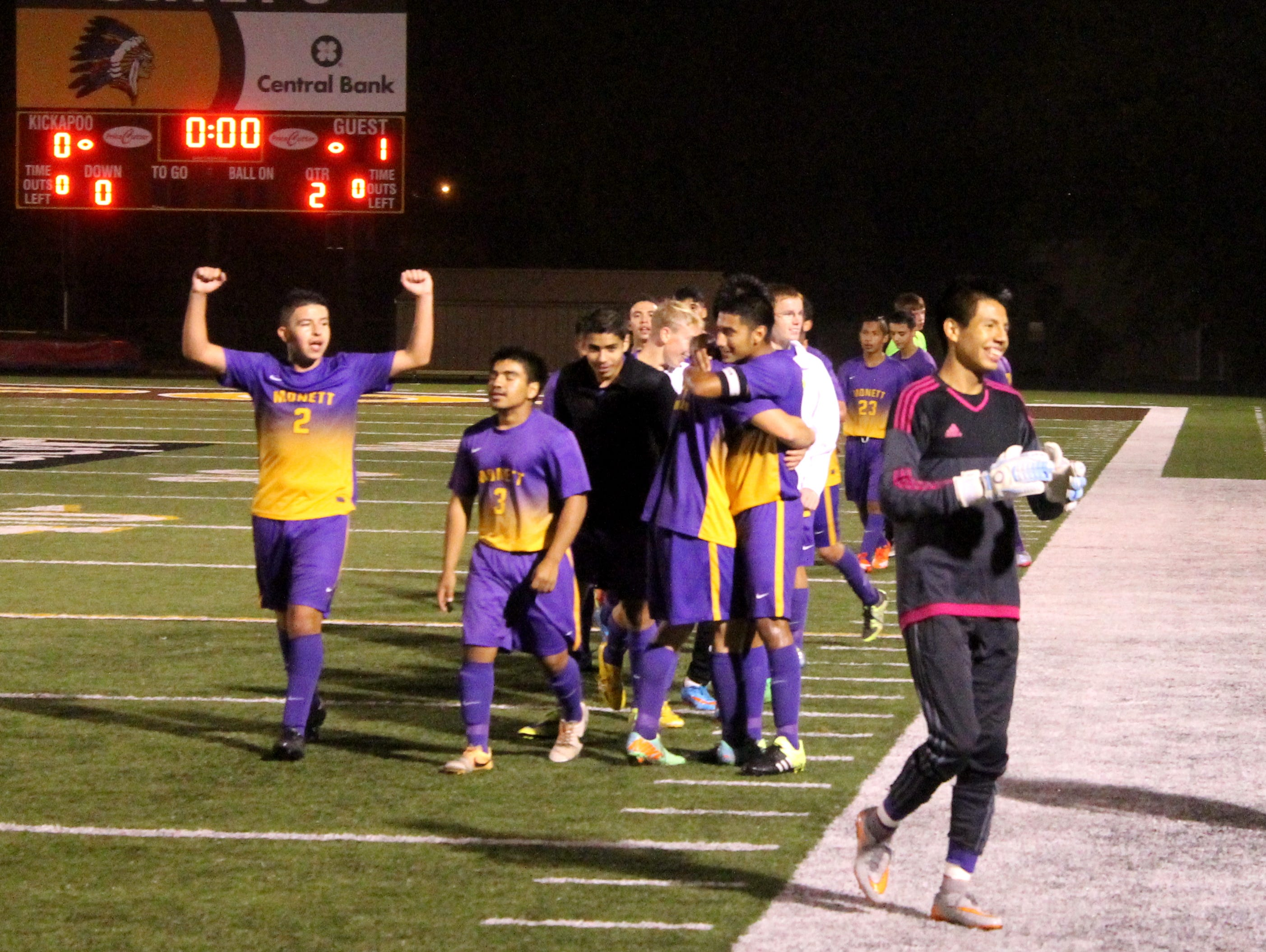 Members of the Monett High School boys soccer team celebrate a 1-0 playoff win over Springfield Catholic at Kickapoo's Pottenger Stadium on Oct. 27.