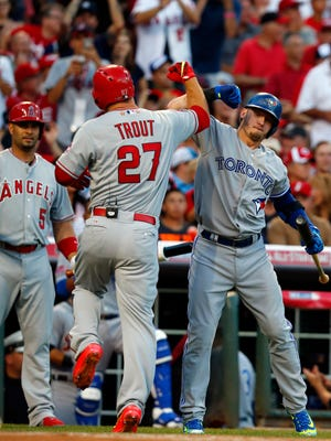 Mike Trout celebrates with Josh Donaldson after hitting a lead off home run.