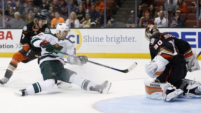 Anaheim Ducks Hampus Lindholm, left, can't stop Minnesota Wild's Nino Niederreiter (22) from scoring a goal past Anaheim Ducks goalie Anton Khudobin (30) in the first period of an NHL hockey game in Anaheim, Calif., Sunday.