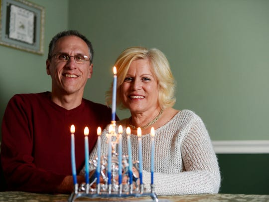 Toby and Kelly Reigart, both of whom converted to Judaism, with their first menorah at their home in York Township.