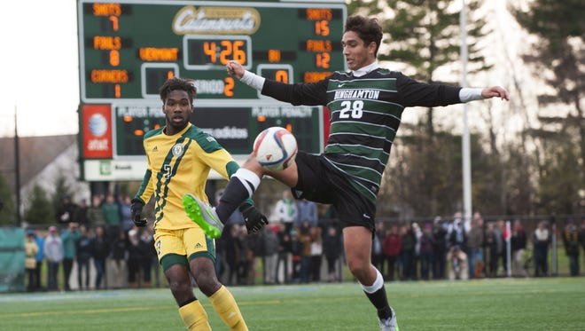 Binghamton University midfielder Florian Orth goes after the ball during Sunday's America East Conference men's soccer championship game in Burlington, Vermont.