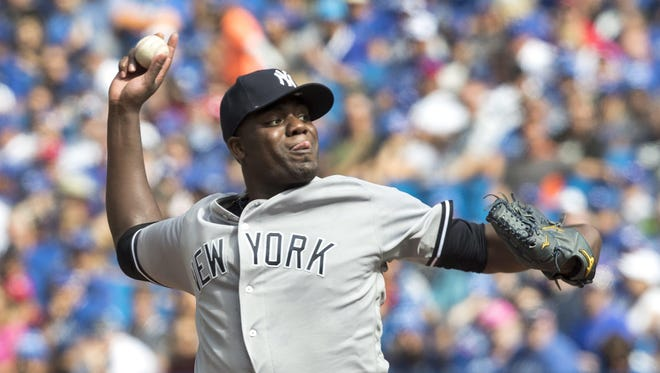 New York Yankees starting pitcher Michael Pineda throws against the Toronto Blue Jays during the first inning of their baseball game in Toronto, Sunday Sept. 25, 2016.