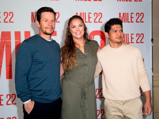 "Mark Wahlberg, from left, Ronda Rousey and Iko Uwais pose during the photo call for ""Mile 22"" on July 28 in Beverly Hills, California."