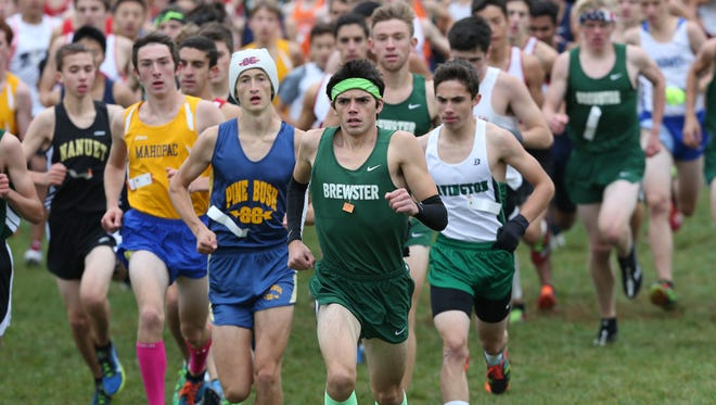 Brewster's Kevin Hazelwood leads the pack at the start of the boys D 2 varsity race during the 38th annual Brewster Bear Classic Cross Country Invitational at Brewster High School Oct. 3, 2015. Hazelwood won the race.