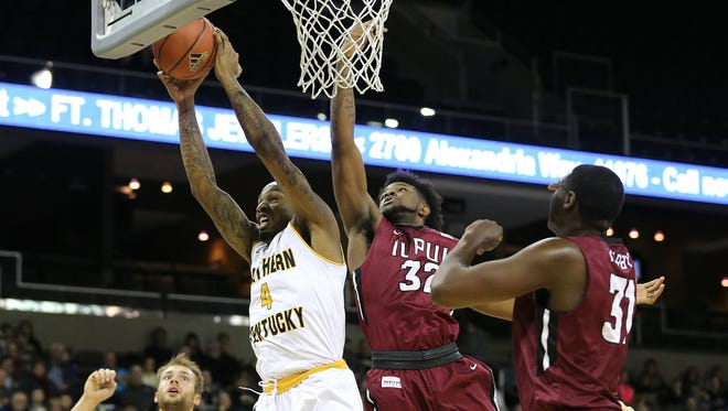 Northern Kentucky Norse forward Jeff Garrett (4) pulls down a rebound over IUPUI Jaguars forward Elyjah Goss (32) in the second half during the college basketball game between the IUPUI Jaguars and the Northern Kentucky Norse, Thursday, Dec. 28, 2017, at BB&T Arena in Highland Heights, Ky.