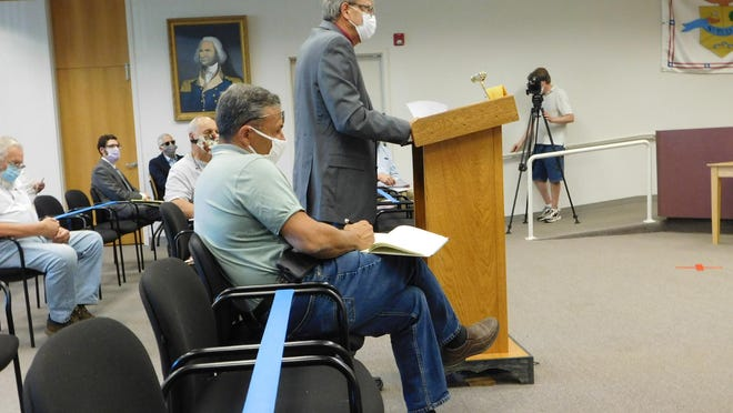 Harold Moss, standing, raises concerns about property access during a hearing Tuesday, July 28, 2020, at the Schuyler Town Hall on a proposed solar farm in the towns of Schuyler and Herkimer.