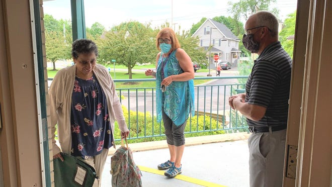 Arc Herkimer staff members prepare welcome a client back to the agency's day program. Submitted photo