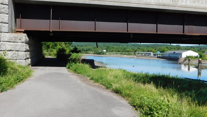 The section of the Erie Canalway Trail between Mohawk and Ilion will pass under the bridge near MOVAC headquarters that carries traffic over the canal and the Mohawk River.
